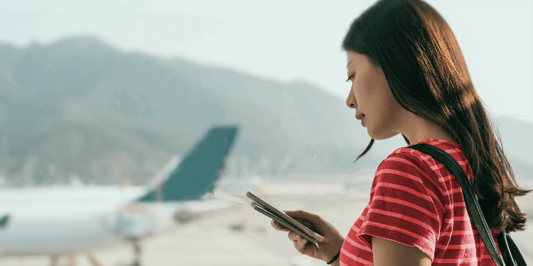 Young woman waiting for flight at the airport.jpg
