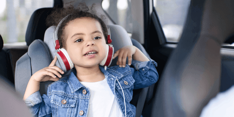 Baby in carseat with headphones.jpg