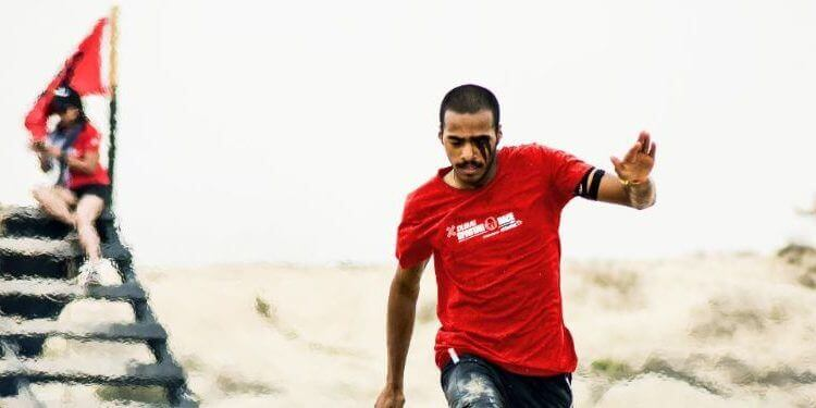 a man participating in Spartan Race obstacle racing challenge .jpg
