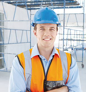 Portrait of a young engineer standing on a construction site
